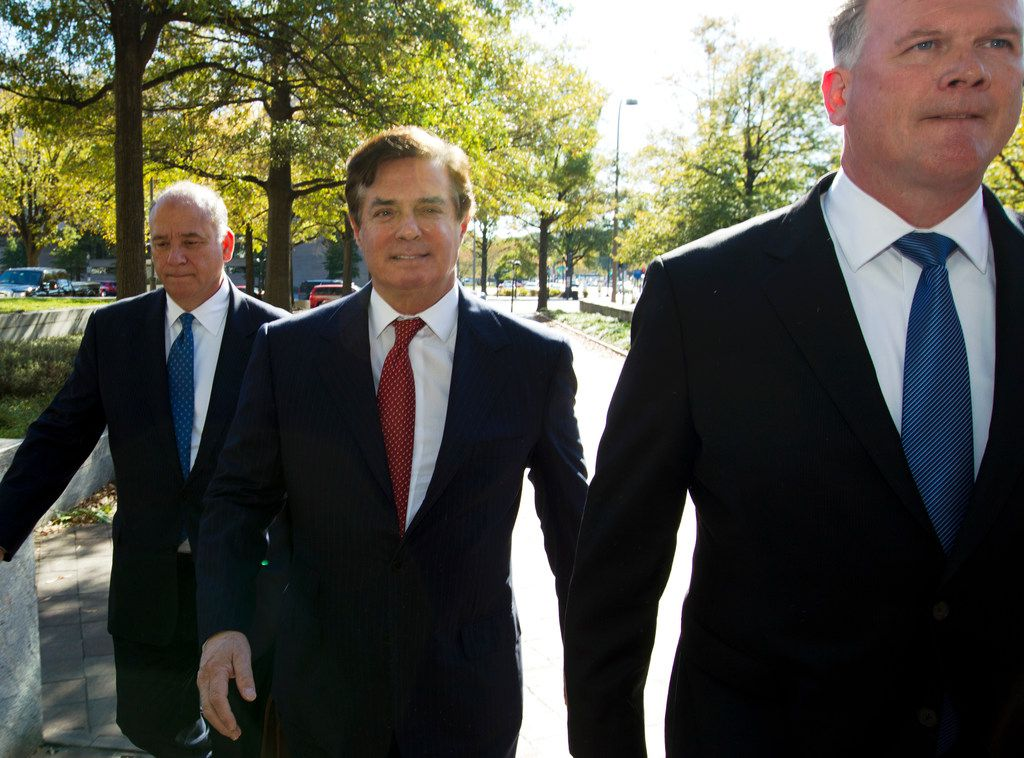 Paul Manafort accompanied by his lawyers, arrives at Federal Court, in Washington, Thursday, Nov. 2, 2017. Manafort, President Donald Trump's former campaign chairman, and Manafort's business associate Rick Gates have pleaded not guilty to felony charges of conspiracy against the United States and other counts. ( AP Photo/Jose Luis Magana)