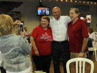 Mary Hill captures a cellphone photo of State Representative Jake Ellzey, center, as he poses with Miriam Williamson and her husband Wylie Williamson. Ellzey was involved in a runoff election with Susan Wright in the race to replace the late Ron Wright's seat in Congress. The election night party was held for Jake Ellzey at the Champions Club at the Texas Motorplex in Ennis on July 27, 2021. (Steve Hamm/ Special Contributor)