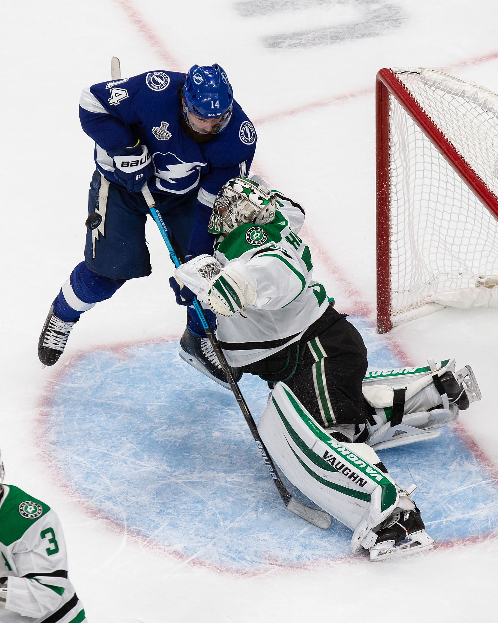 Goaltender Anton Khudobin (35) of the Dallas Stars stops Pat Maroon (14) of the Tampa Bay Lightning during Game Two of the Stanley Cup Final at Rogers Place in Edmonton, Alberta, Canada on Monday, September 21, 2020. (Codie McLachlan/Special Contributor)