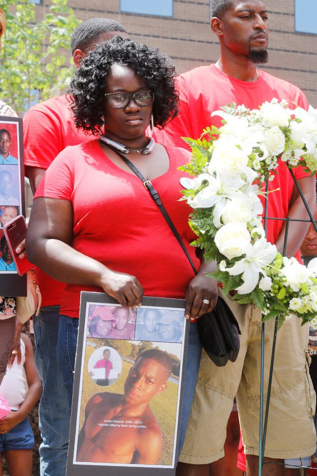 Charmaine Edwards and her husband Odell Edwards, the step-mom and father of Jordan Edwards, stand by a wreath placed on the steps of the Frank Crowley Courts Building during a rally Saturday May 13, 2017 remembering Jordan and others killed by police.