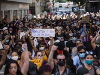 Marchers hold an 8-minute, 46-second moment of silence as they march against police brutality and the recent police killings of George Floyd and Breonna Taylor on Akard St. in downtown Dallas on Saturday, June 6, 2020. (Juan Figueroa/The Dallas Morning News)
