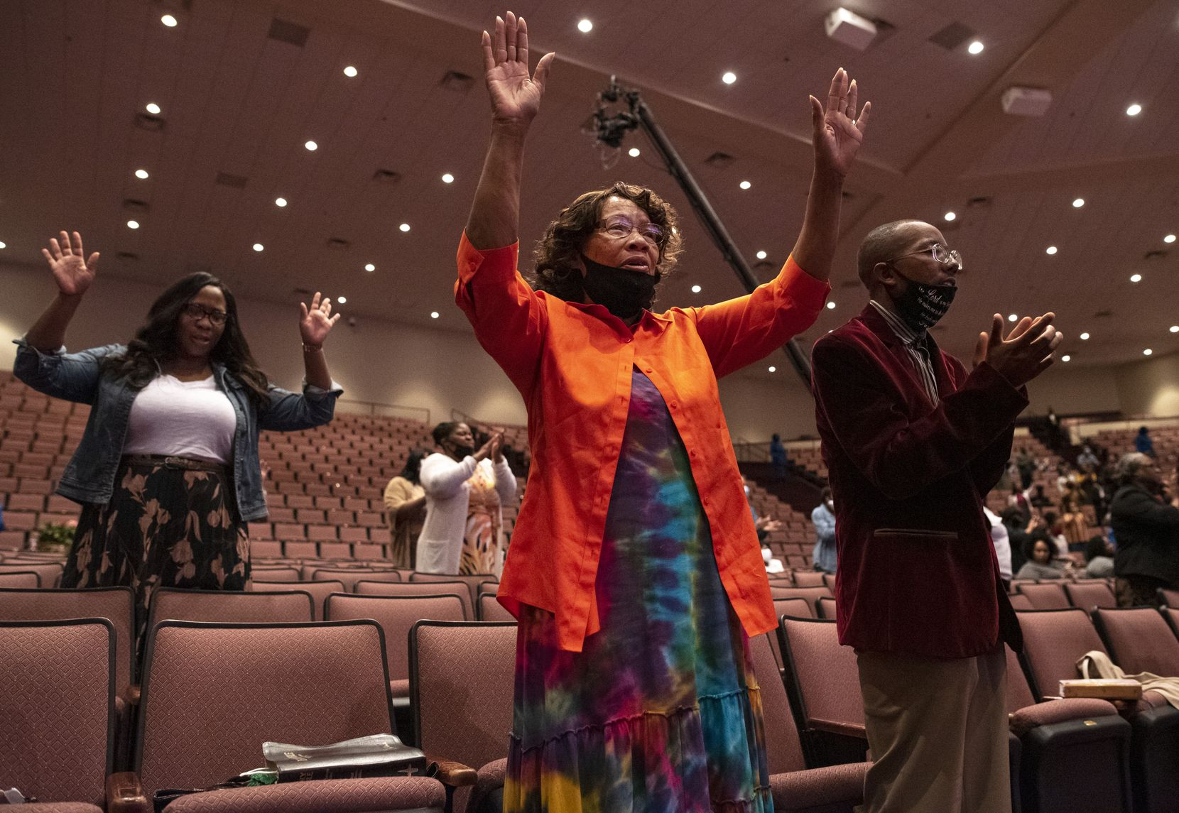 Georgia Williams and her grandson Roland Edmund (right) sing and clap during Bible study at Full Gospel Holy Temple in Dallas.