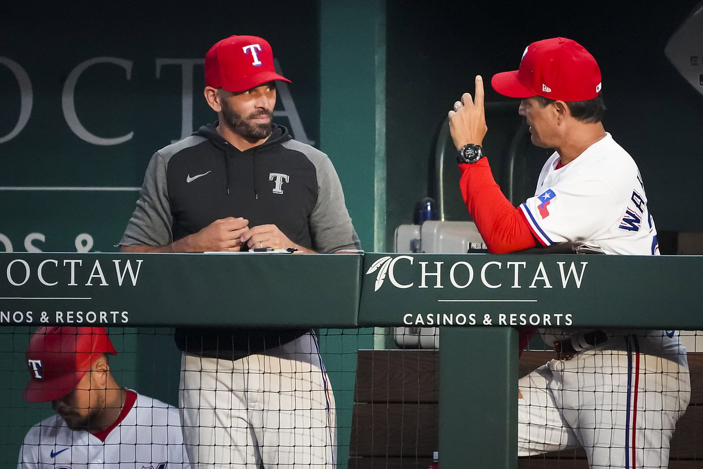 Texas Rangers manager Chris Woodward (left) talks with bench coach Don Wakamatsu in the dugout during the third inning against the Detroit Tigers at Globe Life Field on Tuesday, July 6, 2021.