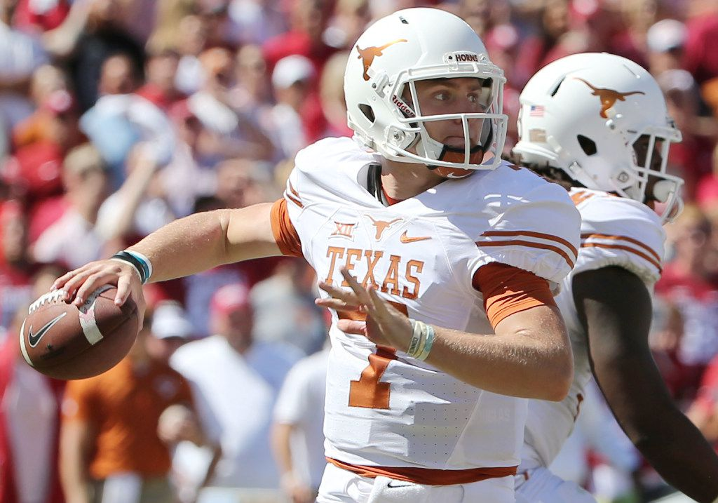 Texas Longhorns quarterback Shane Buechele (7) throws the ball in the first half during the Red River Showdown between the Oklahoma Sooners and Texas Longhorns at the Cotton Bowl at Fair Park in Dallas Saturday October 8, 2016. (Andy Jacobsohn/The Dallas Morning News)