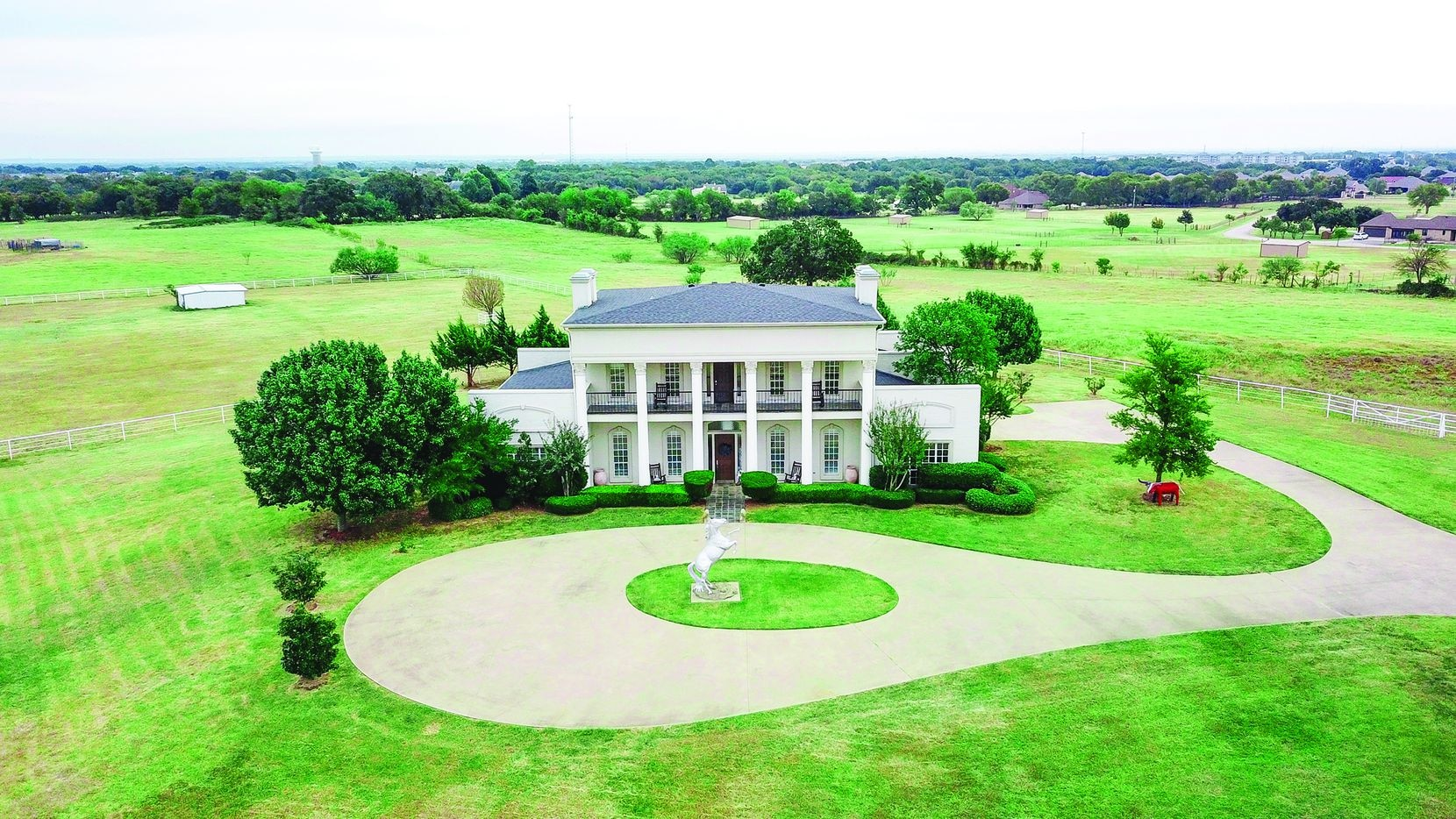 Offered at $1.7 million, the 20-plus-acre ranch at 5500 FM424 in Cross Roads features a main house, pastures, barns, a stable and riding arena.