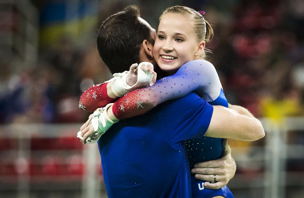 Madison Kocian of the United States celebrates with coach Laurent Landi after her routine on the uneven bars during gymnastics apparatus finals at the Rio 2016 Olympic Games on Sunday, Aug. 14, 2016, in Rio de Janeiro. Kocian, of Dallas, won the silver medal in the event. (Smiley N. Pool/The Dallas Morning News)