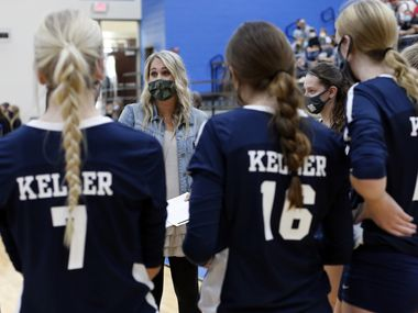 Keller head coach Lauren Rao talks game strategy with her team during a timeout following the second set of their match against Trophy Club Byron Nelson. The two teams played their District 4-6A volleyball match at Byron Nelson High School in Trophy Club on September 29, 2020. (Steve Hamm/ Special Contributor)