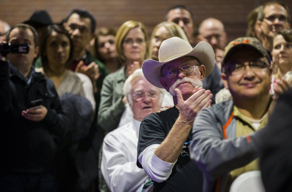 Supporters applaud as U.S. Senator Ted Cruz speaks during a presidential campaign stop at the Mrytle Wilks Community Center in Cisco, Texas on Tuesday, December 29, 2015.