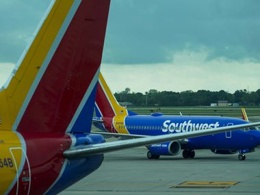 A Southwest Airlines plane heads to the Houston Hobby Airport boarding gate on Friday, March 20, 2020 (Smiley N. Pool / The Dallas Morning News)