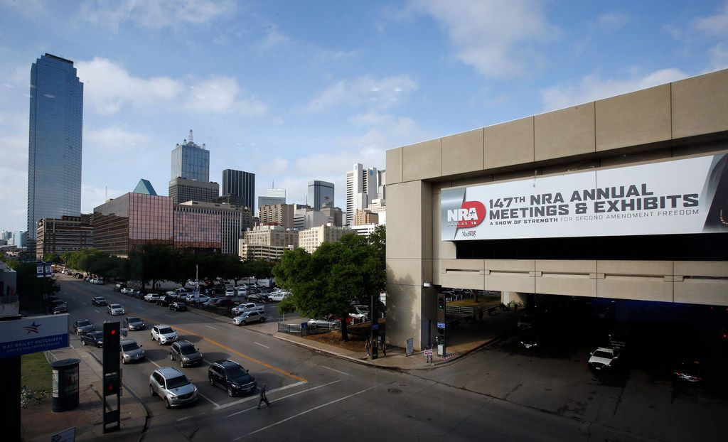 Signage for the National Rifle Association's 2018 convention is shown outside the Kay Bailey Hutchison Convention Center in Dallas earlier in May.