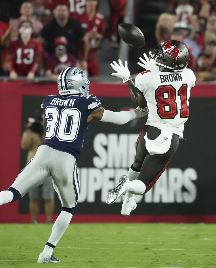 Tampa Bay Buccaneers wide receiver Antonio Brown (81) hauls in a long pass as Dallas Cowboys cornerback Anthony Brown (30) defends during the first half of an NFL football game at Raymond James Stadium on Thursday, Sept. 9, 2021, in Tampa, Fla. (Smiley N. Pool/The Dallas Morning News)