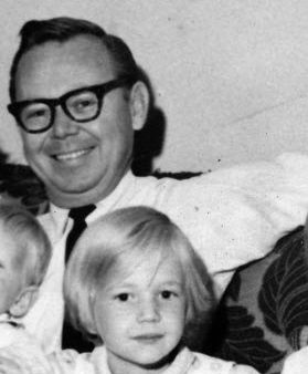 My dad and me in a cropped family photo.