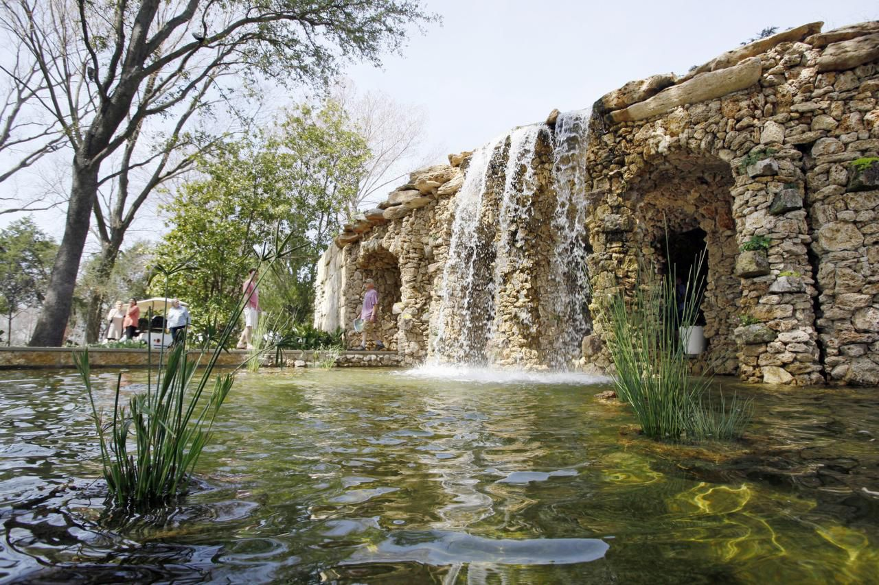 The new grotto and waterfall in the Lay Family Garden were designed by Dallas landscape architect Warren Johnson.