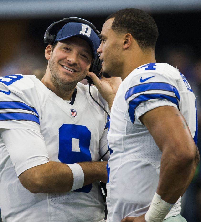 Dallas Cowboys quarterback Tony Romo (9) and quarterback Dak Prescott (4) talk on the sideline during the second quarter of their game against the Baltimore Ravens on Sunday, November 20, 2016 at AT&T Stadium in Arlington, Texas.