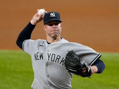 New York Yankees starting pitcher Corey Kluber throws to a Texas Rangers batter during the fifth inning of a baseball game in Arlington, Texas, Wednesday, May 19, 2021. (AP Photo/Tony Gutierrez)