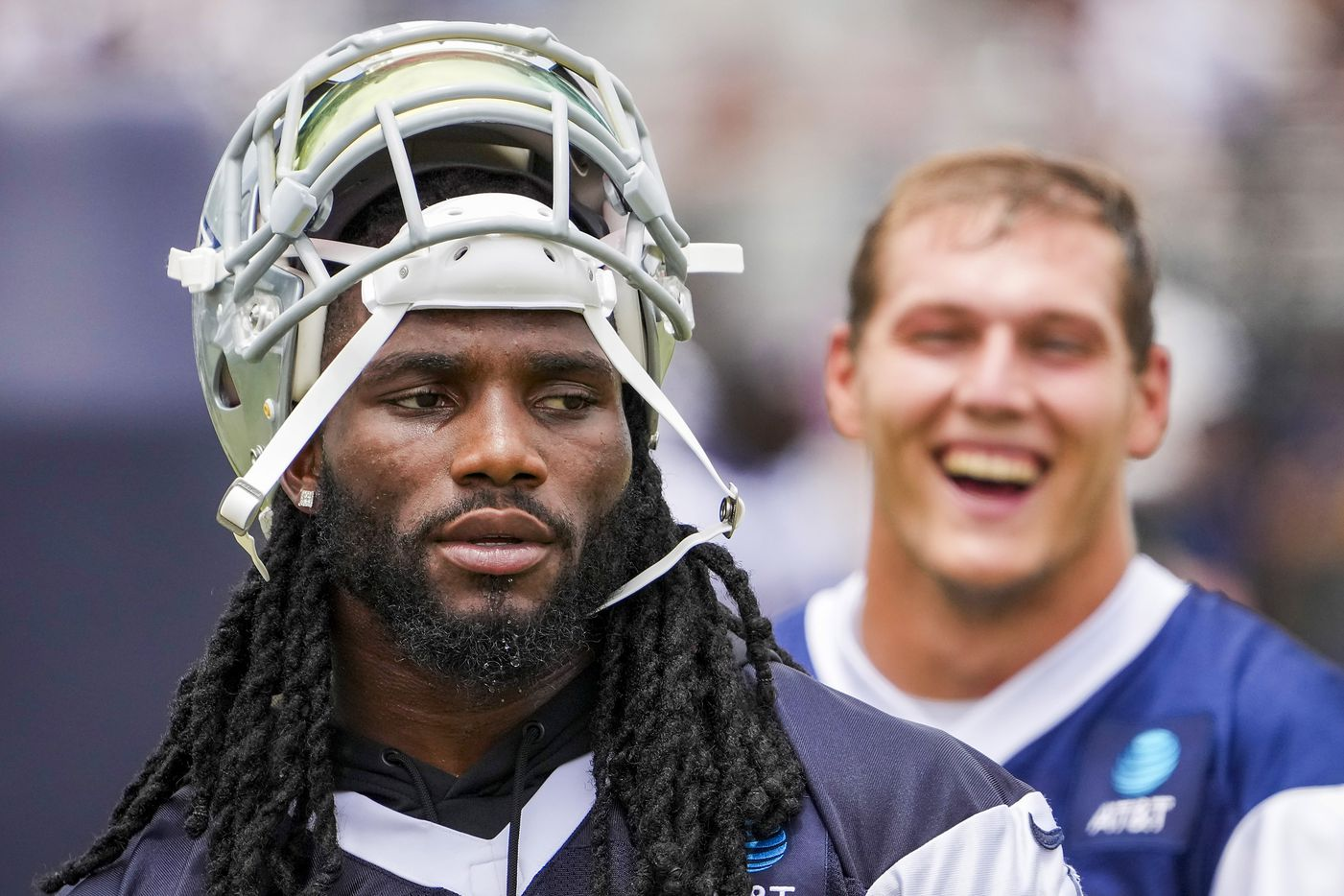 Dallas Cowboys linebacker Jaylon Smith (9) and linebacker Leighton Vander Esch (55) watch a drill during a practice at training camp on Saturday, July 24, 2021, in Oxnard, Calif.