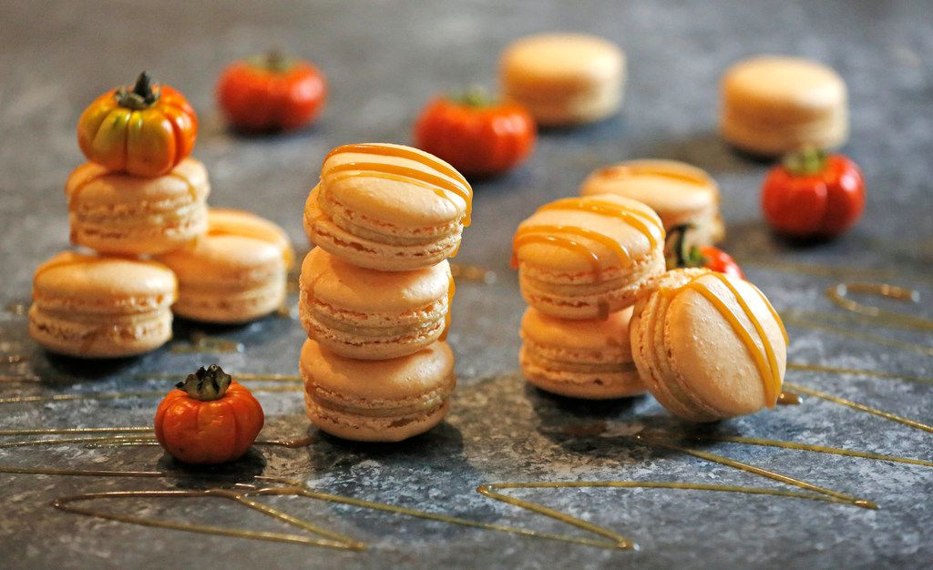 Pumpkin Spice Caramel Macarons are drizzled with caramel sauce.