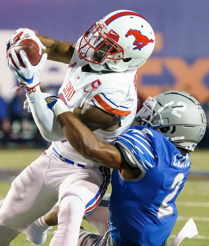 SMU wide receiver James Proche (3) catches a pass as Memphis defensive back T.J. Carter (2) defends during the first half of an NCAA football game at Liberty Bowl Memorial Stadium on Saturday, Nov. 2, 2019, in Memphis, Tenn. (Smiley N. Pool/The Dallas Morning News)