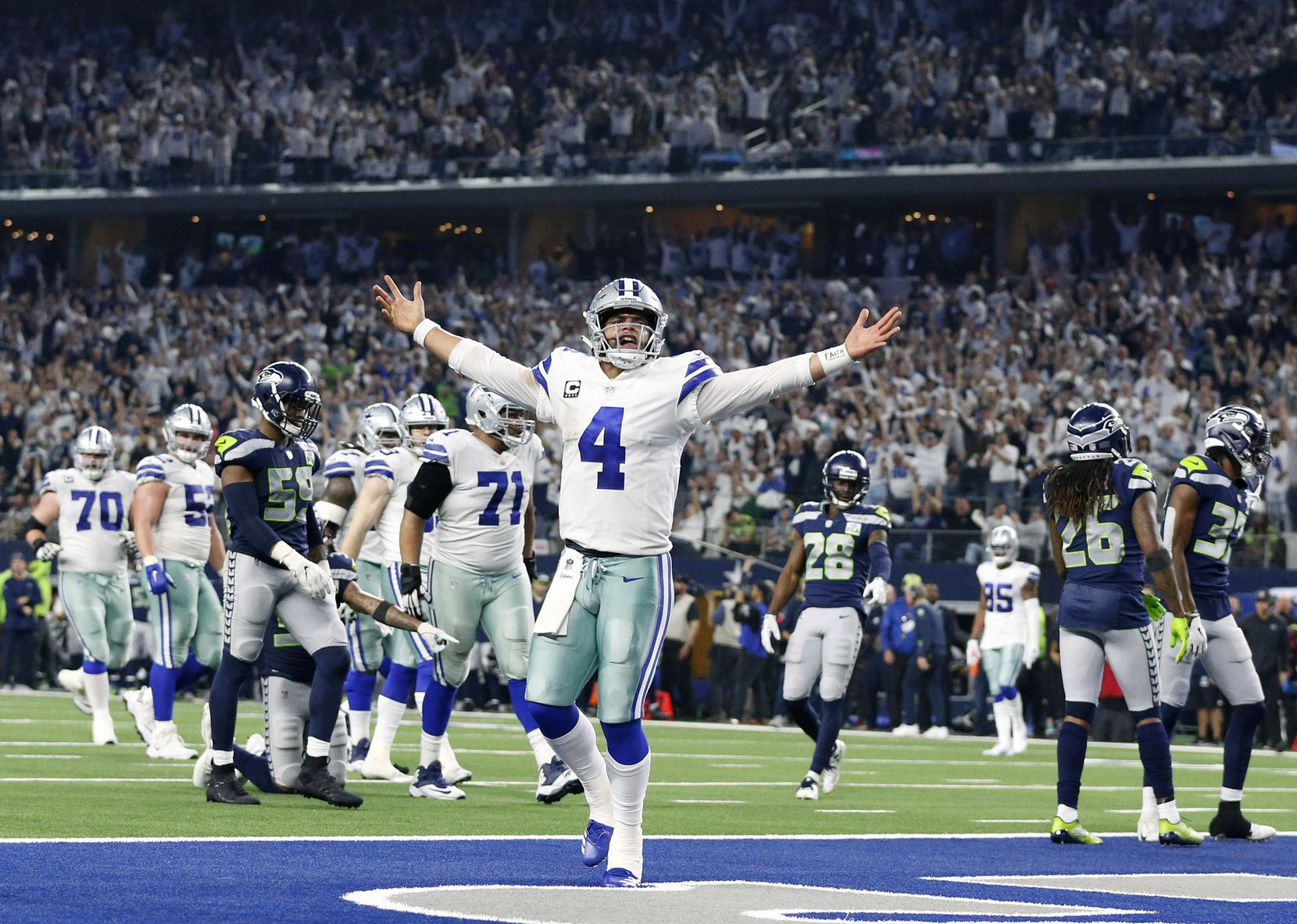 Dallas Cowboys quarterback Dak Prescott (4) celebrates after what what he thought was a fourth quarter touchdown in their NFC Wild Card win over the Seattle Seahawks at AT&T Stadium in Arlington, Texas, Saturday, January 5, 2019. Dak came up short but ran in the touchdown a couple plays later. The Cowboys won, 24-22. (Tom Fox/The Dallas Morning News)
