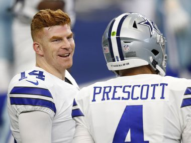 Dallas Cowboys quarterback Andy Dalton (14) talks with Dallas Cowboys quarterback Dak Prescott (4) during warmups before a game against the Cleveland Browns at AT&T Stadium in Arlington, Texas on Saturday, October 4, 2020.