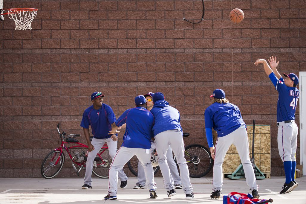 Texas Rangers pitcher Derek Holland shoots a free throw on a basketball court setup outside the Rangers clubhouse before a spring training workout at Surprise Stadium on Thursday, March 3, 2016, in Surprise, Ariz. (Smiley N. Pool/The Dallas Morning News)