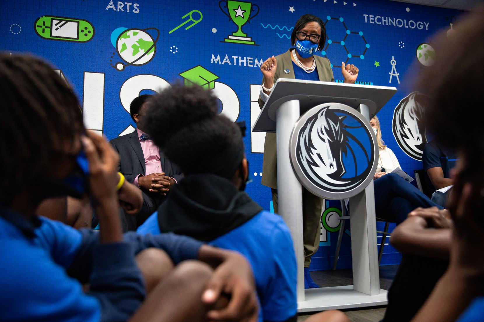 CEO of the Dallas Mavericks Cynthia Marshall talks to kids in YMCA's Teen Camp about all they can do at the Mavs Foundation's newest reading and learning center renovation at the Moorland YMCA at Oak Cliff on August 3, 2021. (Shelby Tauber / Special Contributor)