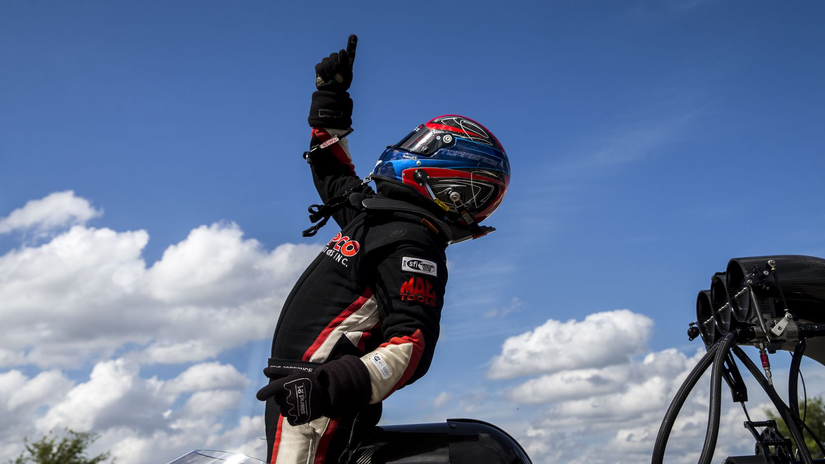Steve Torrence celebrates after advancing to the final in the top fuel race during the AAA Texas NHRA Fall Nationals at Texas Motorplex in Ennis, Texas on Sunday, October 7, 2018.