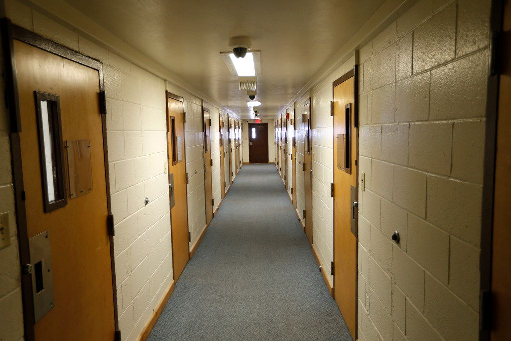 A hallway in one of the dorms at the Gainesville State School on Feb. 26, 2018. Each room has a single bed.