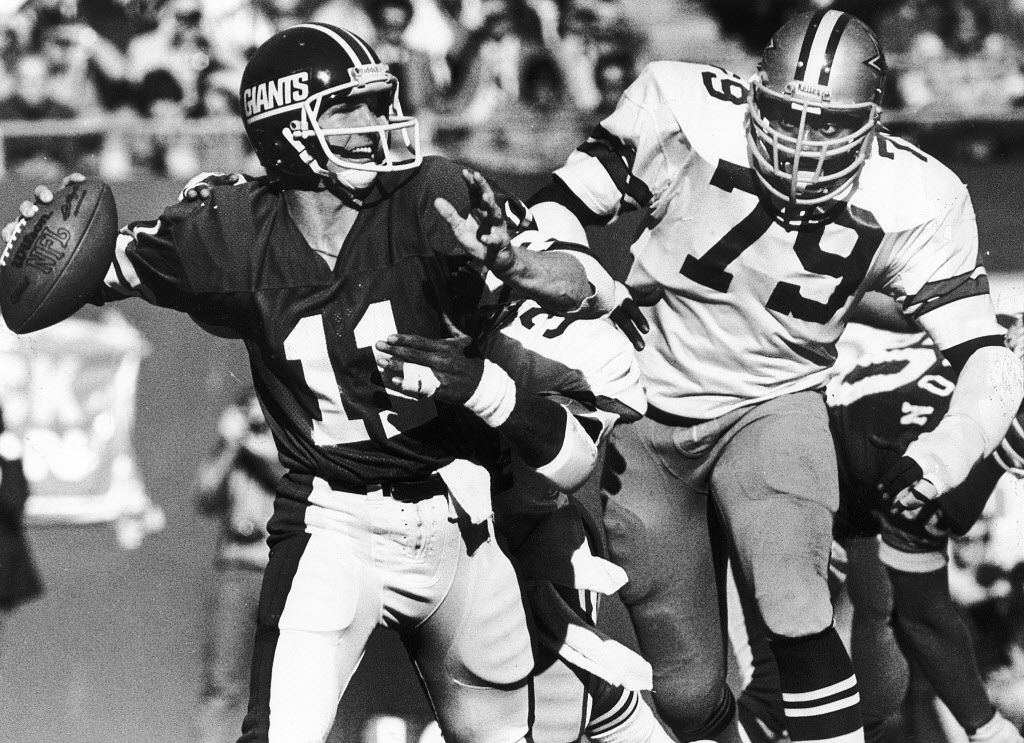 1979 -- Harvey Martin, shown zeroing in on Giants quarterback Phil Simms, played for the Cowboys from 1973 through 1983.
