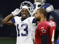 Dallas Cowboys wide receiver Michael Gallup (13) visits with his quarterback Dak Prescott (4) during Training Camp practice at The Star in Frisco, Texas, Wednesday, August 18, 2021.(Tom Fox/The Dallas Morning News)