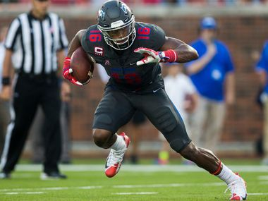 FILE - SMU wide receiver Courtland Sutton (16) runs with the ball during the second quarter of a game against Arkansas State on Saturday, Sept. 23, 2017, at Ford Stadium in Dallas.