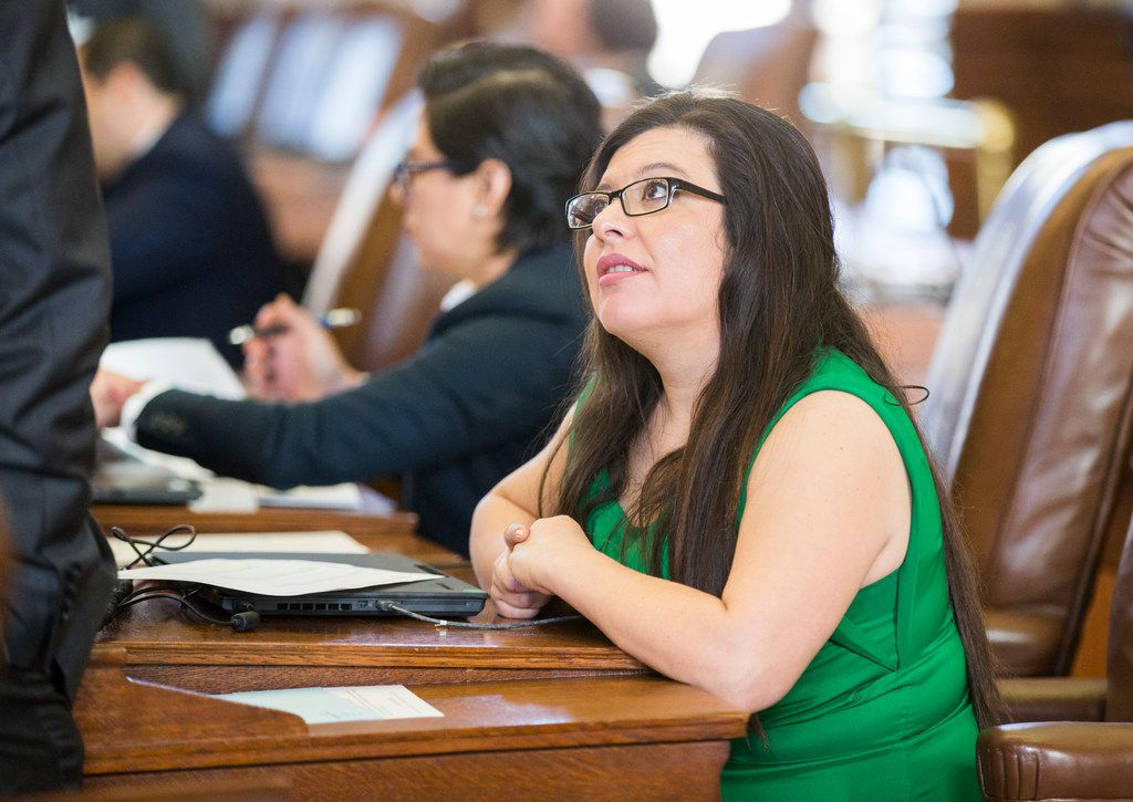 Rep. Mary González, D-El Paso, talks with another representative on the second day of the 86th Texas legislature on Wednesday at the Texas Capitol in Austin. González, who identifies as pansexual, is the chair of the state Legislature's first LGBTQ caucus.