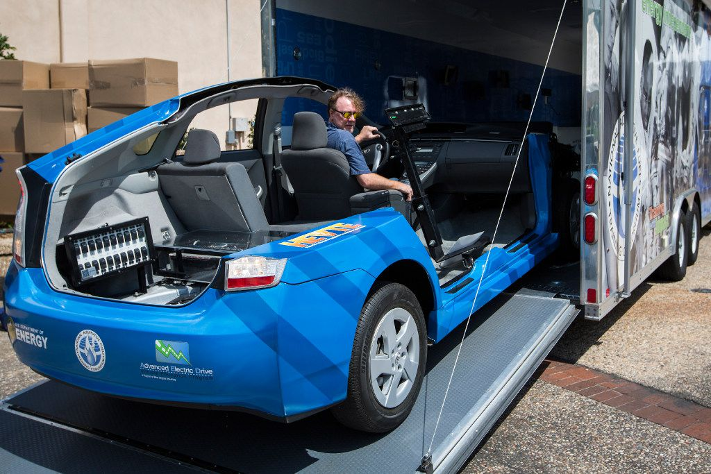 Michael Smyth of the West Virginia University National Alternative Fuels Training Consortium drives a cut-away Toyota Prius from a trailer during set up for Earth Day Texas 2017 at Fair Park on Wednesday, April 19, 2017, in Dallas. (Smiley N. Pool/The Dallas Morning News)