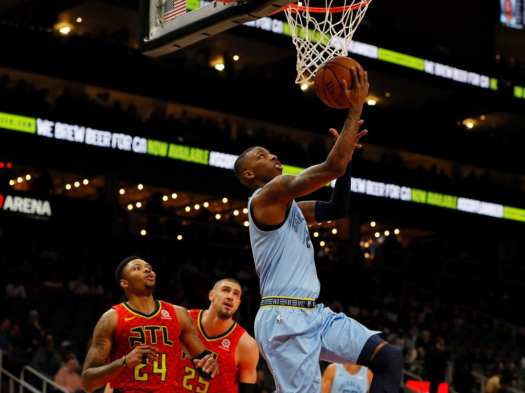 ATLANTA, GEORGIA - MARCH 13:  Delon Wright #2 of the Memphis Grizzlies attacks the basket past Kent Bazemore #24 and Alex Len #25 of the Atlanta Hawks in the first half at State Farm Arena on March 13, 2019 in Atlanta, Georgia. (Photo by Kevin C.  Cox/Getty Images)
