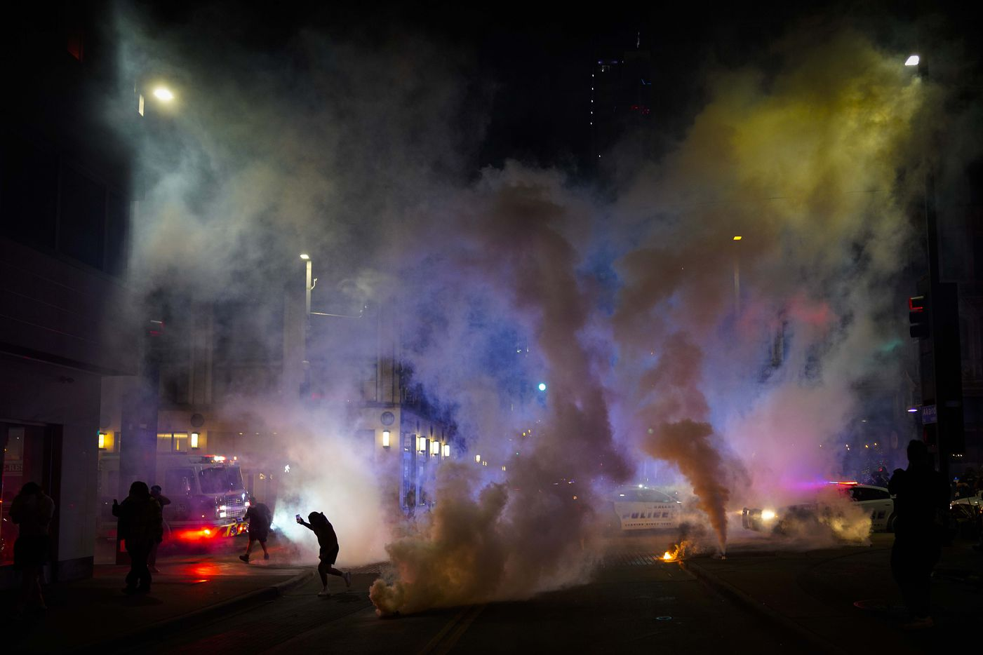 Teargas is deployed by Dallas police to disperse a group of people at the corner of Akard and Main Streets downtown following a protest against police brutality in the early morning hours of Saturday, May 30, 2020, in Dallas.