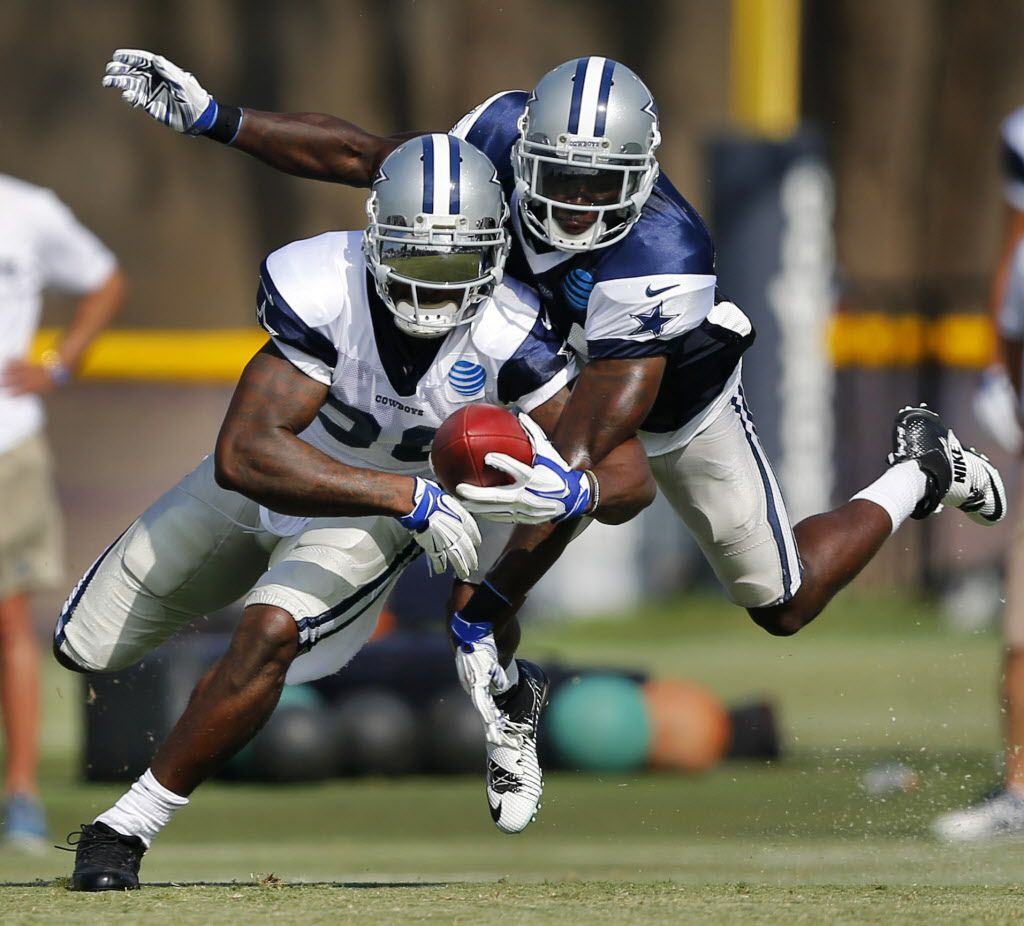 Dallas Cowboys wide receiver Dez Bryant (88) has the ball momentarily before cornerback Morris Claiborne (24) knocks the pass of his hands during afternoon practice at training camp in Oxnard, California, Tuesday, August 2, 2016. (Tom Fox/The Dallas Morning News)