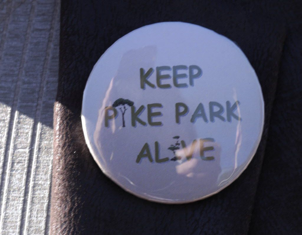 Keep Pike Park Alive pins were worn by supporters of the park at the commemoration of the renovation of Pike Park on Nov. 1, 2013.