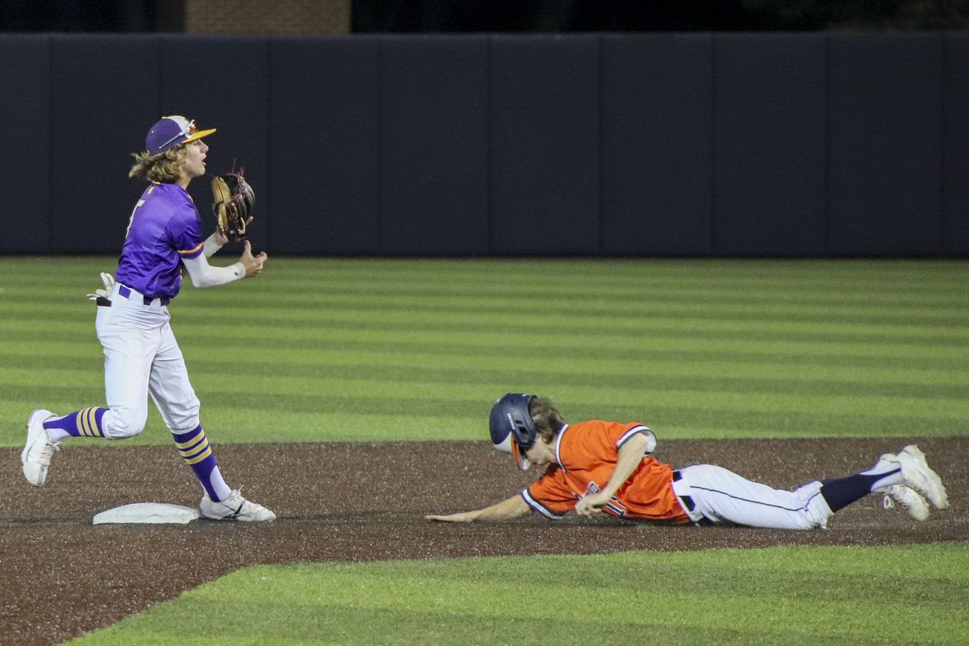 Hallsville second baseman Dunagan Sawyer (5) forces out Frisco Wakeland pinch runner Cooper Huff (18) during game two of the UIL baseball 5A Region II final series at Horner Ballpark in Dallas on Friday, June 4, 2021. (Elias Valverde II / Special Contributor)