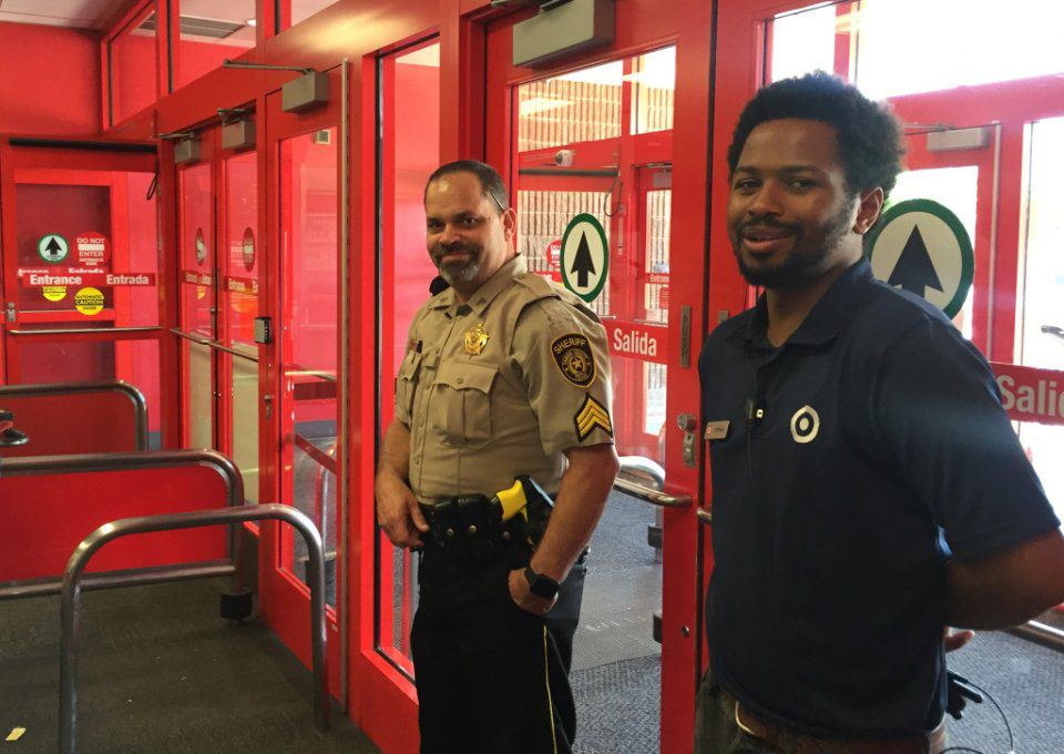 A security guard and sheriff's deputy watched the exit of the store in Cityplace.