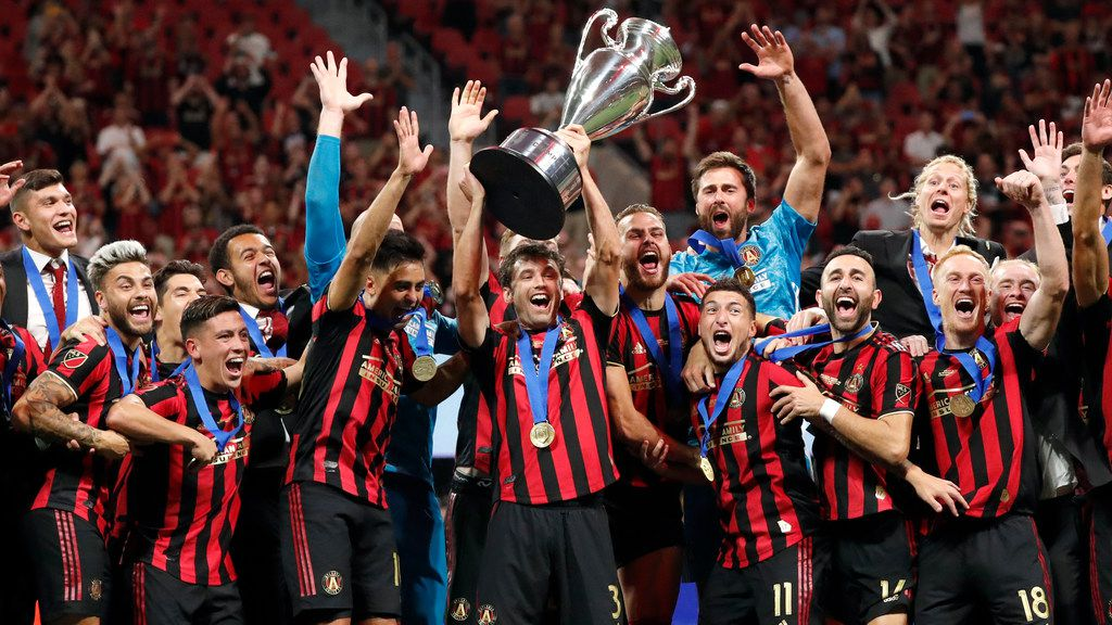 Atlanta United players celebrate after defeating the Minnesota United inthe U.S. Open Cup soccer match Tuesday, Aug. 27, 2019, in Atlanta. (AP Photo/John Bazemore)
