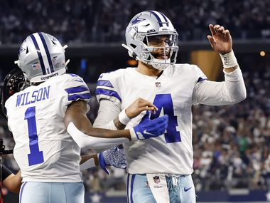 Dallas Cowboys quarterback Dak Prescott (4) congratulates wide receiver Ced Wilson (1) after his fourth quarter touchdown at AT&T Stadium in Arlington, Monday, September 27, 2021. (Tom Fox/The Dallas Morning News)