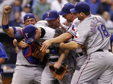 FILE - Rangers players Bengie Molina (11), Cliff Lee (33), Michael Young (10), David Murphy and Mitch Moreland (18) celebrate after beating the Rays in Game 5 of the ALDS at Tropicana Field in St. Petersburg, Fla., on Oct. 12, 2010.