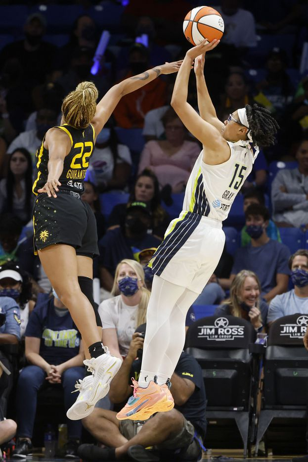 Dallas Wings guard Allisha Gray (15) shoots as she is defended by Los Angeles Sparks guard Arella Guirantes (22) during the first half of a WNBA basketball game in Arlington, Texas on Sunday, Sept. 19, 2021. (Michael Ainsworth/Special Contributor)