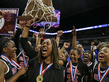 Duncanville head coach LaJeanna Howard holds the Trophy in a 6A final on  Saturday, March 7, 2020 at the Alamodome.