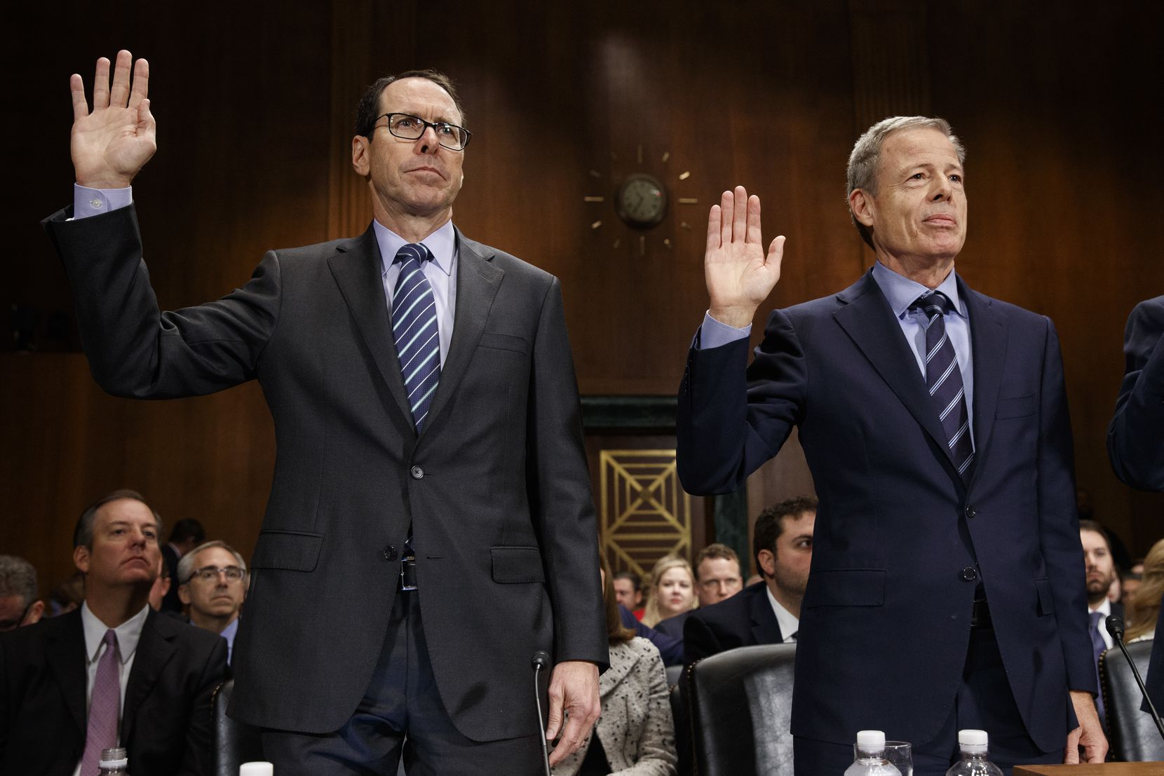 AT&T Chairman and CEO Randall Stephenson, left, and Time Warner Chairman and CEO Jeffrey Bewkes are sworn in on Capitol Hill in Washington, Wednesday, Dec. 7, 2016, prior to testifying before a Senate Judiciary subcommittee hearing on the proposed merger between AT&T and Time Warner.