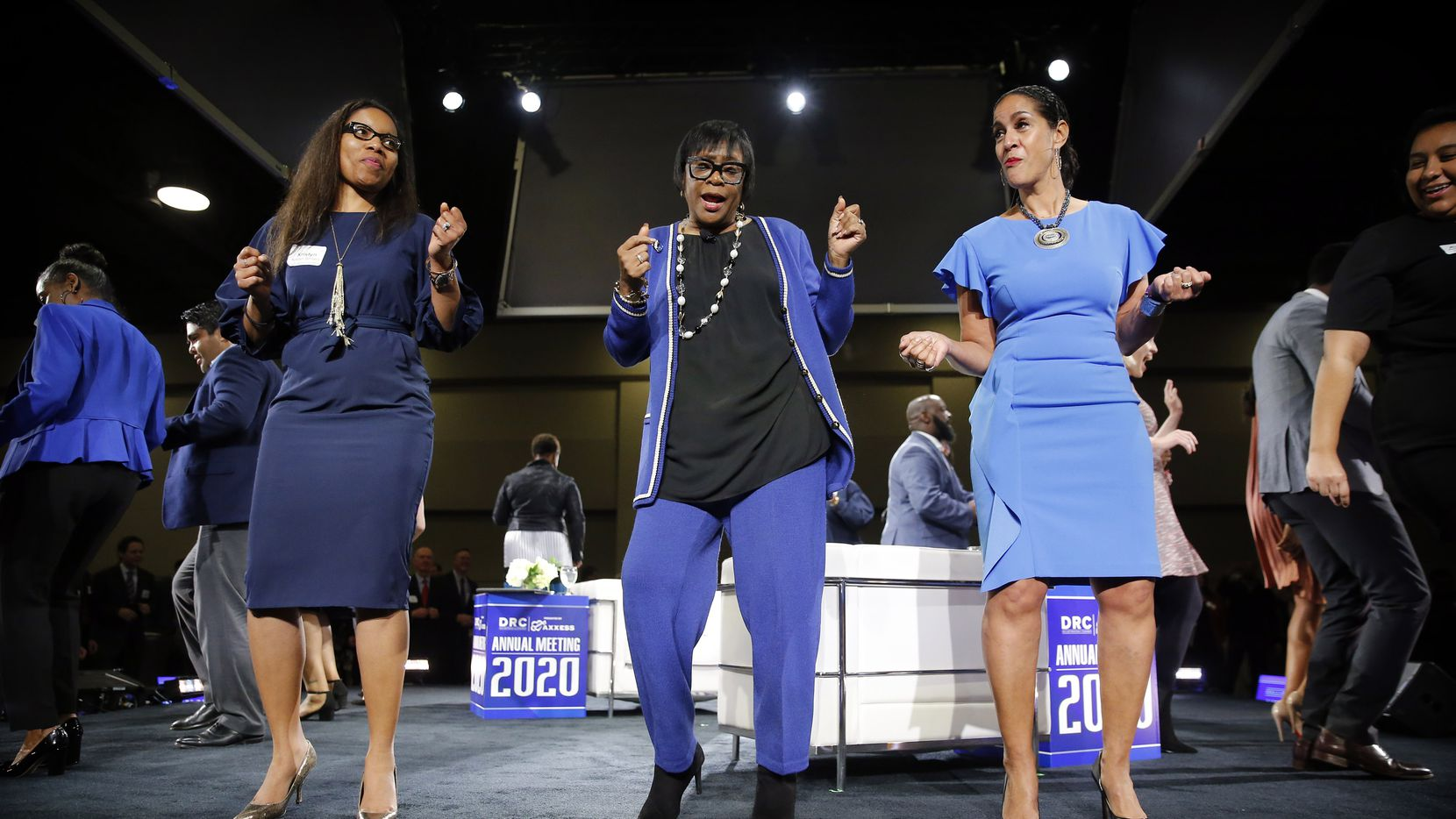 Dallas Mavericks CEO Cynt Marshall (center), Texas Women's Foundation, senior director of communications Kristyn Senters (left) and Women of Power chief brand officer Caroline Clarke (right) dance to the Cupid shuffle to close out the keynote conversation at Dallas Regional Chamber's annual meeting and luncheon at the Hilton Anatole hotel in Dallas on Thursday. (Tom Fox/The Dallas Morning News)