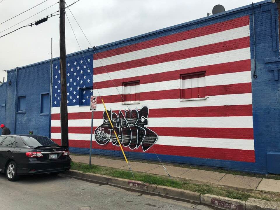 A photo posted by Dallas restaurant owner Pete Zotos shows the defaced mural.