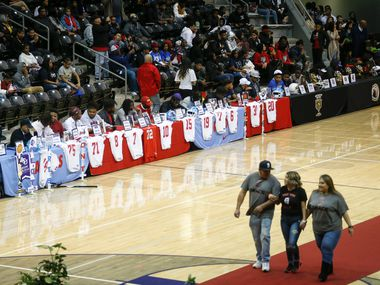 Players take their seats during a Dallas ISD signing day event at Ellis Davis Field House on Wednesday, Feb. 5, 2020 in Dallas. (Ryan Michalesko/The Dallas Morning News)