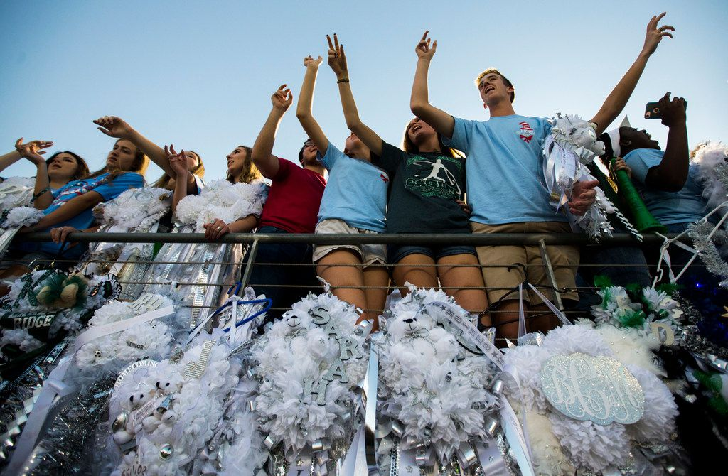 Mansfield Lake Ridge High School students sang their school song above homecoming mums before a football game between Lancaster and Lake Ridge last September at Vernon Newsom Stadium in Mansfield.