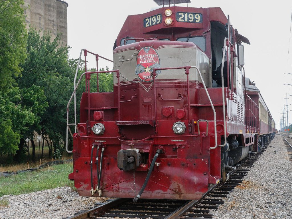 "The 1953 diesel locomotive, ""Vinny,""  of the Grapevine Vintage Railroad prepares to depart downtown Grapevine in this file photo. (Ron Baselice/The Dallas Morning News)"